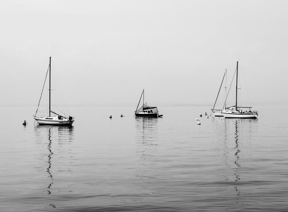 A misty and dull morning on Lake Garda