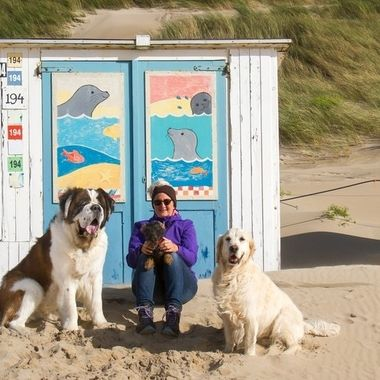 My wife posing with our Saint Bernard, Golden Retriever and Dachshund in front of a lovely decorated beach house at the isle of Texel, Holland