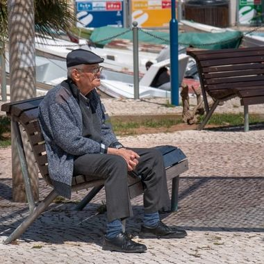 Old man at the harbor in Fuseta, Portugal