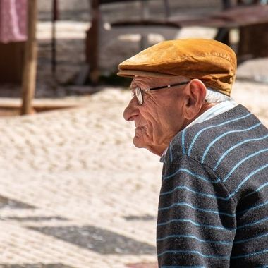 Old man at a square in Fuseta, Portugal