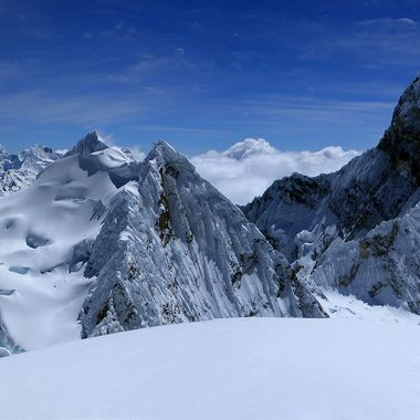Taken at 5752 metres on a climbing expedition in Peru. We spent an hour on the top in perfect conditions. The level of difficulty is similar to Mont Blanc except for one steep section requiring front points and two ice axes. The famous Alpamayo is on the left and the extremely difficult Chacaraju on the right.