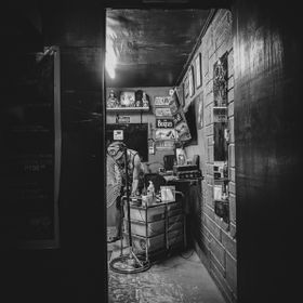 A took a pic of my friend in his tattoo shop when I saw the door for the framing and the textures for a good BW.