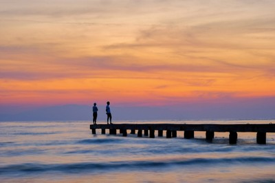 two persons on pier