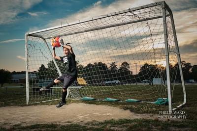 Soccer goalie. Action shot portrait using a single strobe.