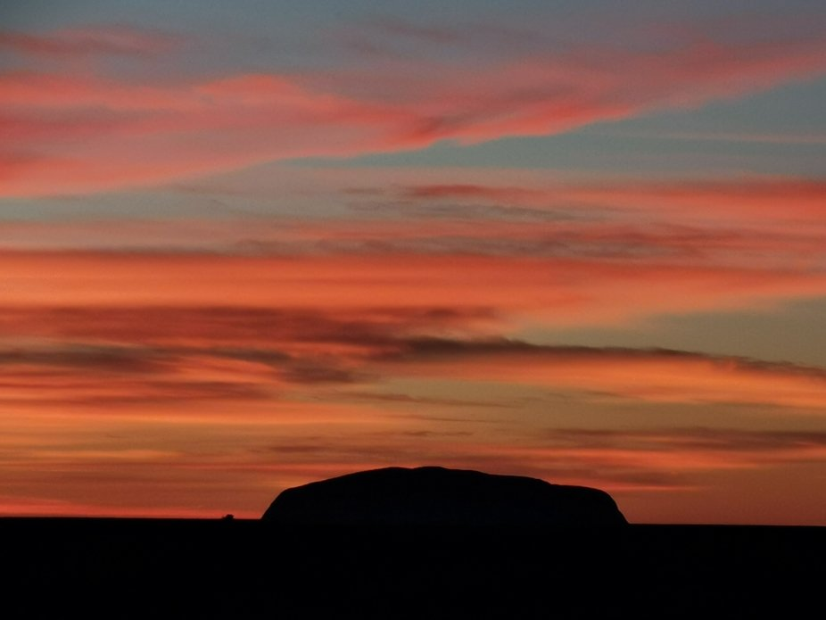 I took this photo in May 2019 whilst watching the beautiful sunrise over Ayers Rock, one of the m...