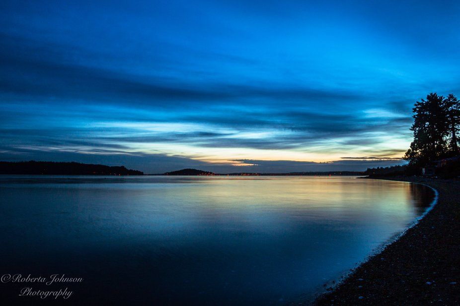 Stunning blues swept the sky during the blue hour this morning on Hood Canal. Hoods Head and the ...