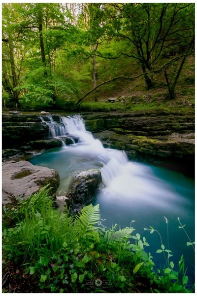 Two images blended in PS of the lower falls in Brecon Park, Wales, Uk