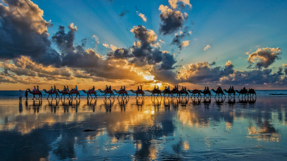 Sunset rides on camels at Cable Beach, Broome, Western Australia.