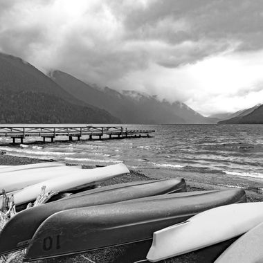 A storm is brewing over Lake Quinault in the Olympic Penninsula, Washington.  Canoes are hunkered down waiting for the downpour.