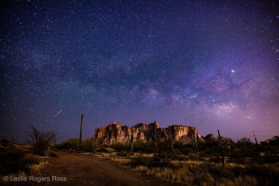 The Milky Way appears over the Superstition Mountains in Arizona