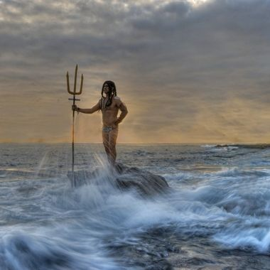 Poseidon standing on a rock