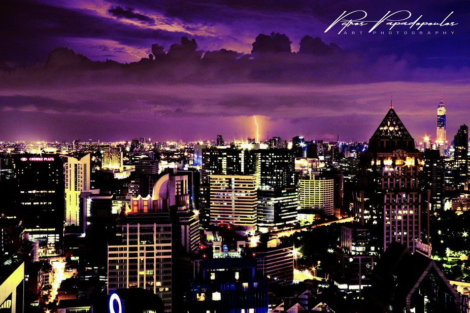 this photo taken from the roof of a 42 story tower block in central Bankok on a stormy night