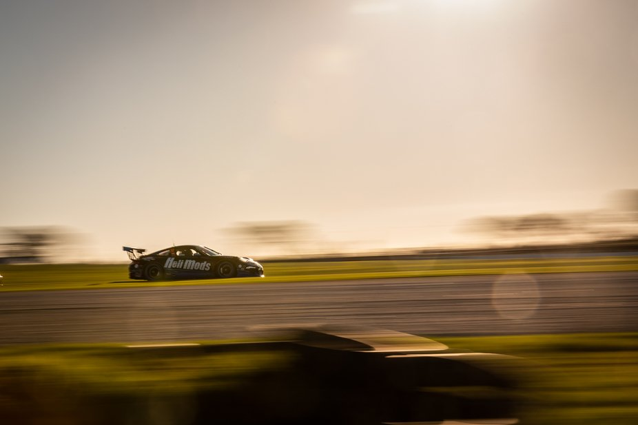 Harri Jones exiting Southern Loop in the late afternoon sun in his Porsche 911 GT3 Cup at the Phillip Island round of the 2019 Shannons Nationals