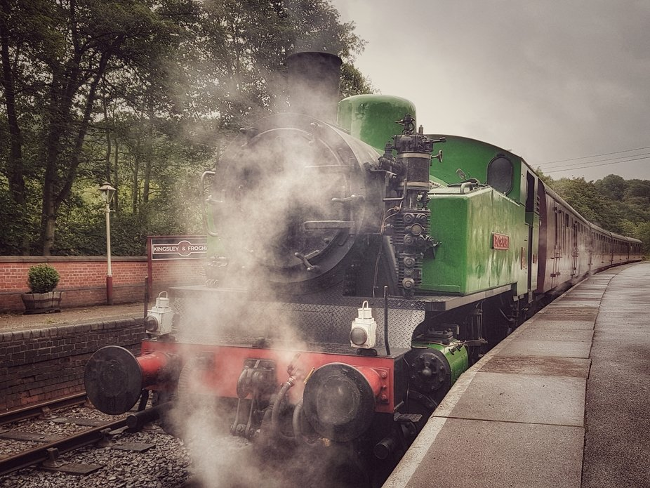#photo of  a steam train at the station