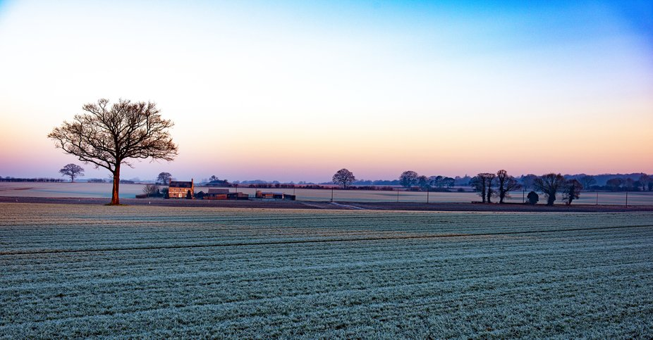 Landscape overlooking a farm house in winter