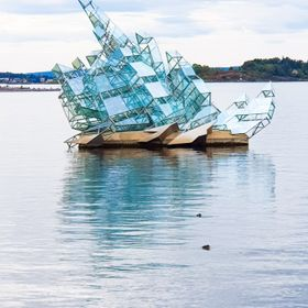 glass sculpture in the sea next the opera house in Oslo Norway