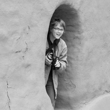 My son giggling after surreptitiously having taken a shot of me wile visiting Pecos Pueblo National Historic Monument near Pecos, New Mexico.