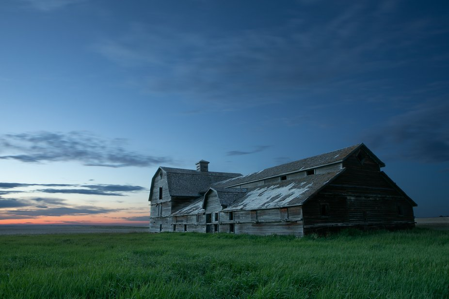 A huge old barn on the back roads of Alberta. A long exposure as the sun was setting.