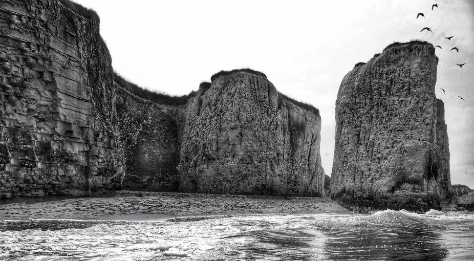 Taken from waist deep in the sea looking back towards the cliffs.
