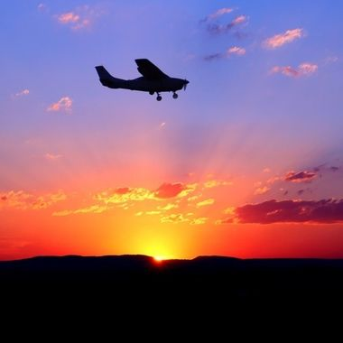 Adrian Mcleish - Sunset silouette plane 3 - Dragon Fire Photography 2019