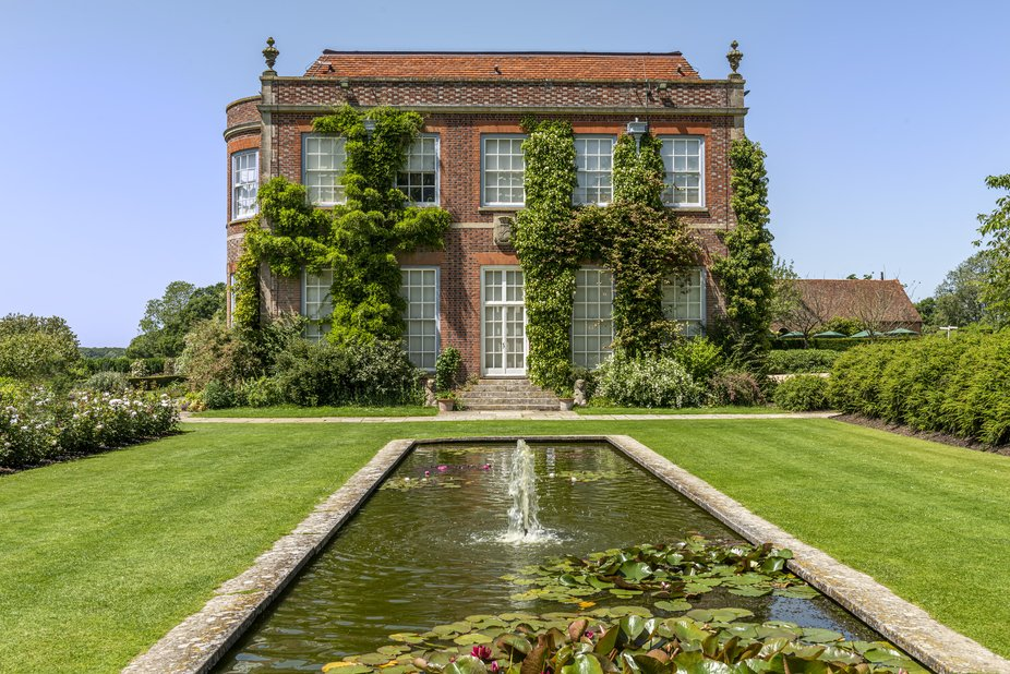 This elegant country manor and tranquil garden sit so harmoniously within the landscape that one ...