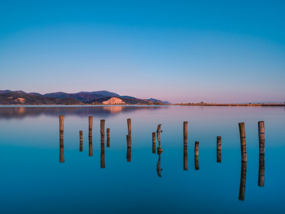 Calm reflections of Massaciuccoli lake.