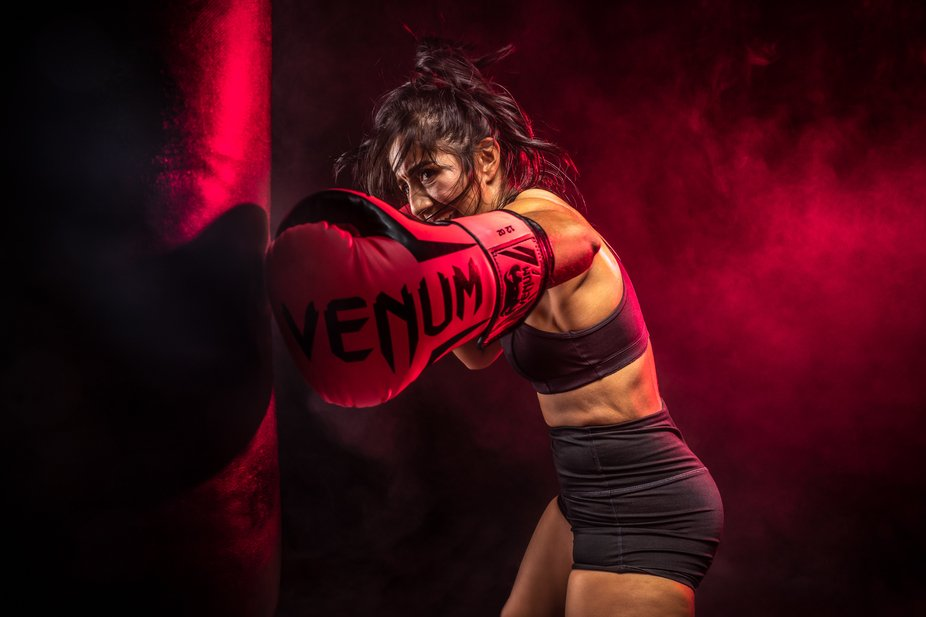 Boxer showing her intensity and hard work on the heavy bag