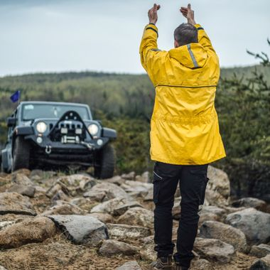 A guide ensures safe passage for a Jeeper on a rocky trail.  Near Notre-Dame-de-la-Merci, QC, Canada