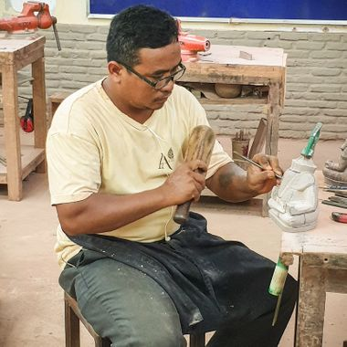 This gentleman was learning how to carve traditional stone sculptures. This particular image was captured during a recent visit to Cambodia.