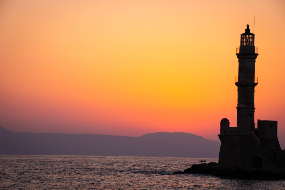 The lighthouse in Chania harbour, Crete GR, in the sunset.