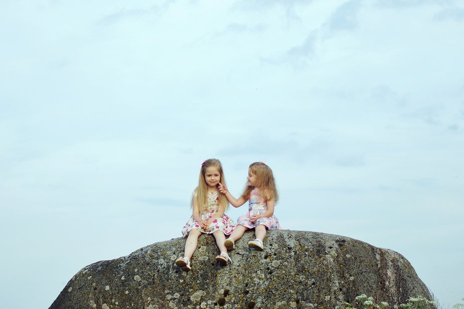 Two girls on a stone