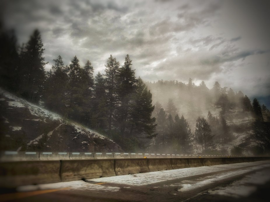 Had very high winds and rain that left a pile of hail on the highway!