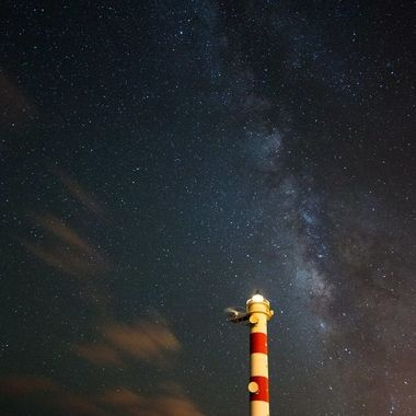 Lighthouse and milky way