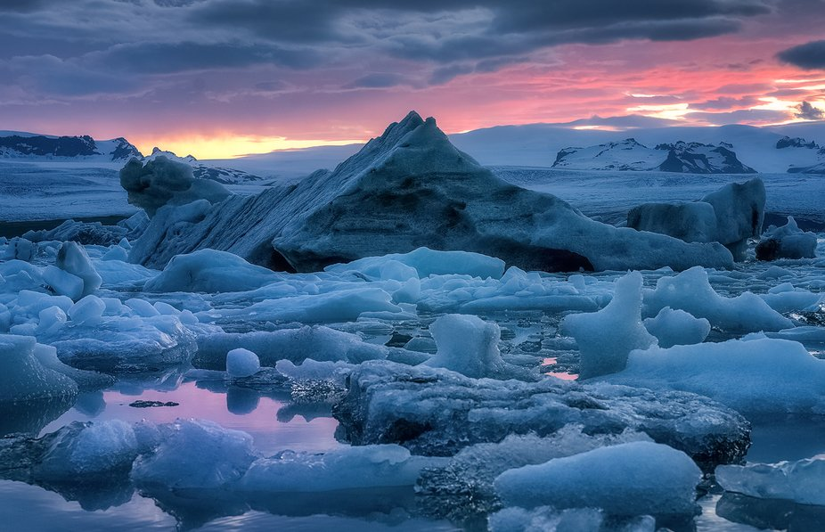 This pyramid-shaped glacier dominates the landscape as its subjects fade away, floating towards t...