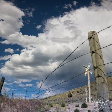 Grasshopper Creek Montana. Railroad crossing and barbed wire fencing.