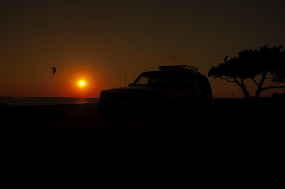 Sunset on the sound side of the ocean. My jeep in the foreground.