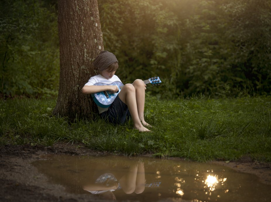 my son playing his little guitar following an angry storm the day before, which gifted us a tiny ...