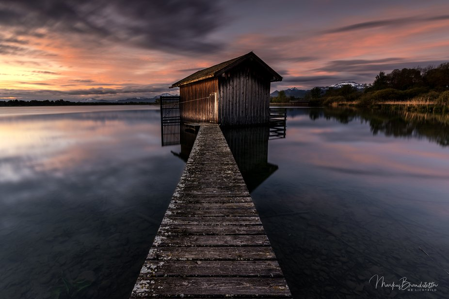 A lovely tiny boathouse at sunrise in the Bavarian Alps