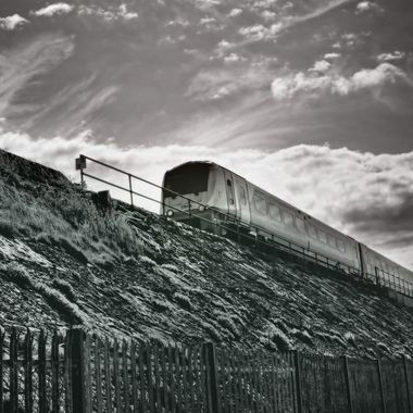 Train coursing along the North Wales Coast.