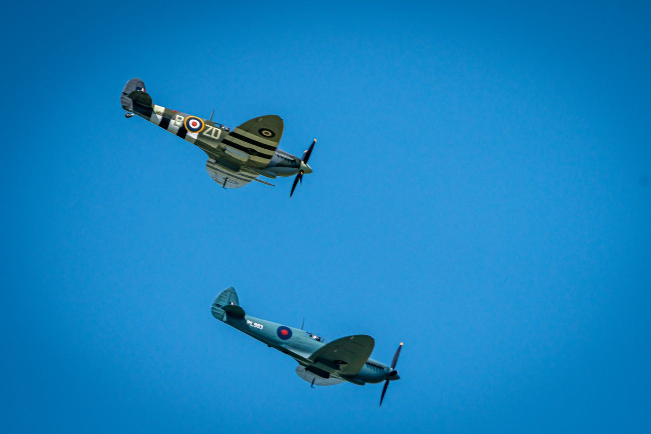 A Spitfire and a Hurricane flying over Heveningham Hall, Suffolk