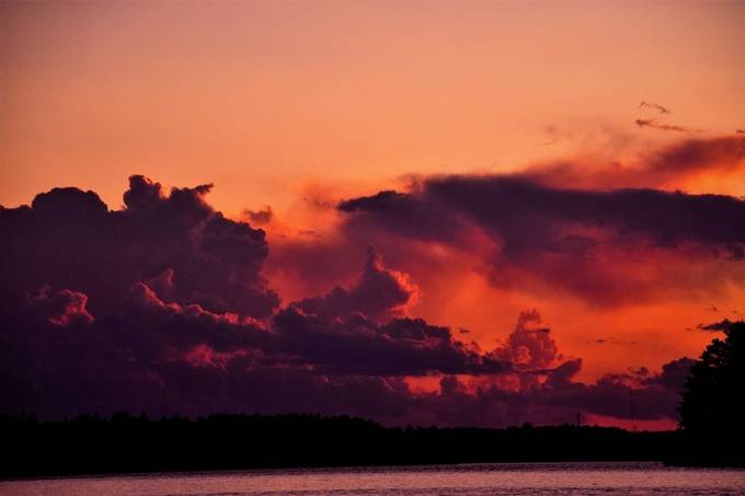 Sunset on the edge of a summer storm! Nikon D7200 Tamron 18-400 lens Taken from a boat on the lake.