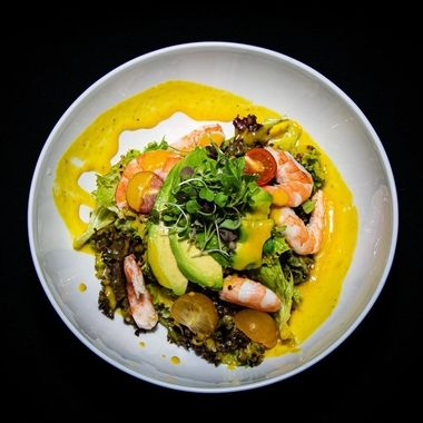 a tropical prawn and avocado salad taken from a birds eye view