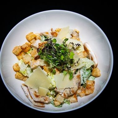 a classic take on the traditional fresh Chicken Ceaser salad with chicken, croutons and parmesan cheese