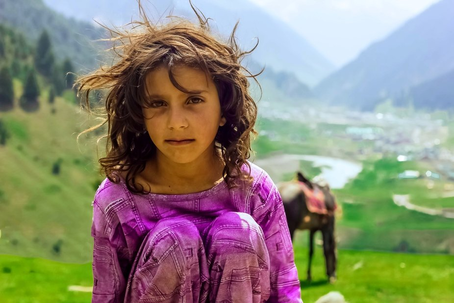 I took this portrait of a shepherd girl while camping and trekking in mountains near the remotest...