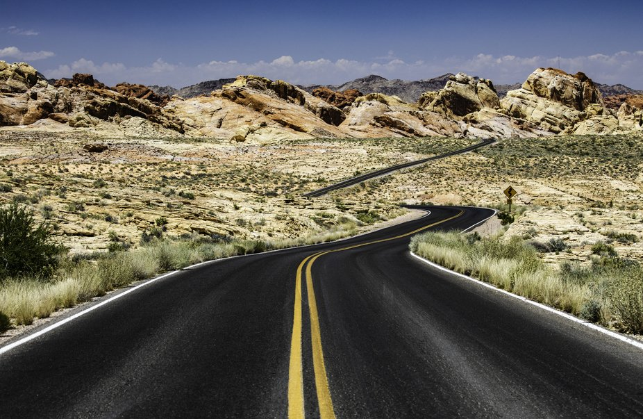 Desolate road leading deeper into the Valley of Fire state park in Nevada.