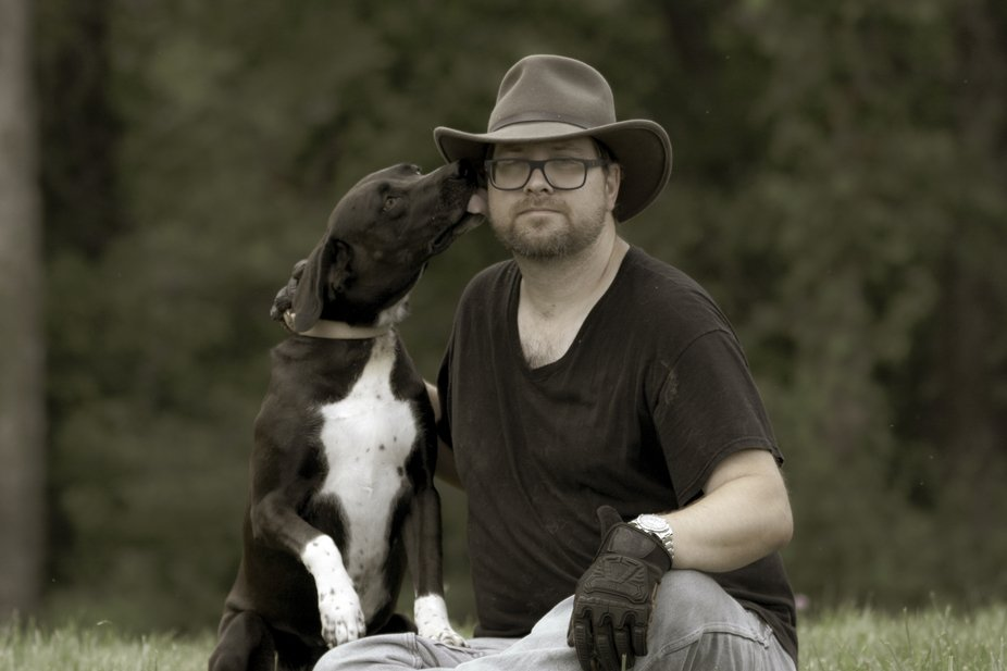 my husband and his dog out in our yard