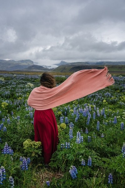 Flowing scarf in a fliwer field somewhere in iceland