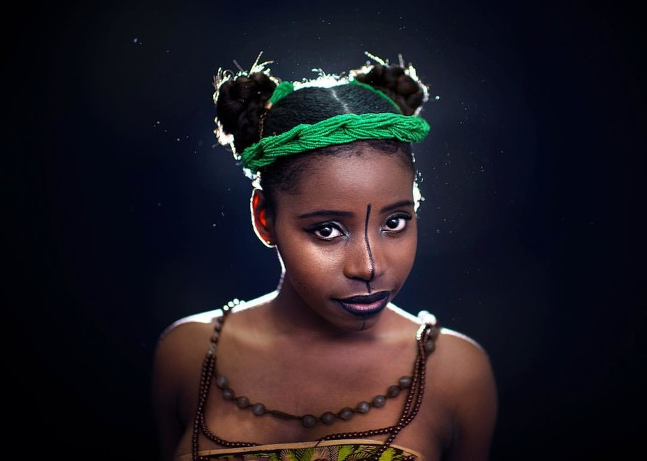 Cute little makoli in her African clothes. Studio portrait. Model: Bea Mako.