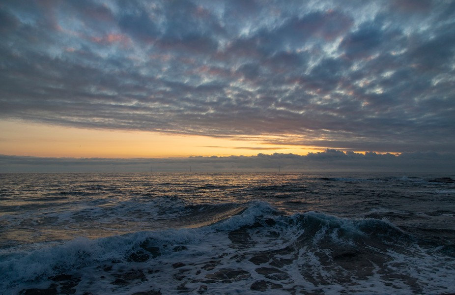 A beautiful sunrise along with a high tide and great formations of clouds