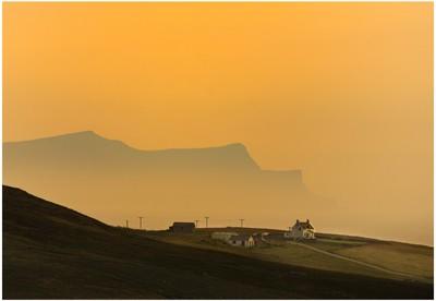 Setting sun engulfing the island of Foula